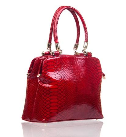 red purse: Luxury female handbag over white