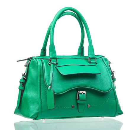 woman handle success: Green female handbag over white background