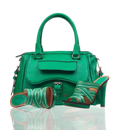 Green summer shoes and handbag over white photo