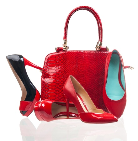 patent leather: Red fashion women shoes and handbag over white