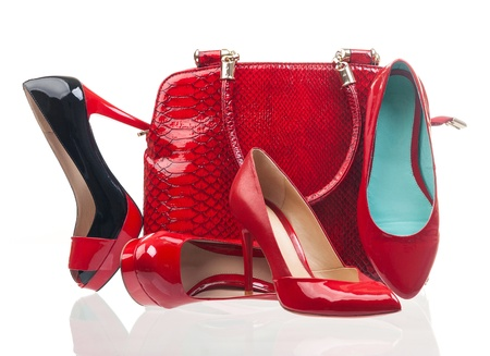 Red fashion women shoes and handbag over white photo