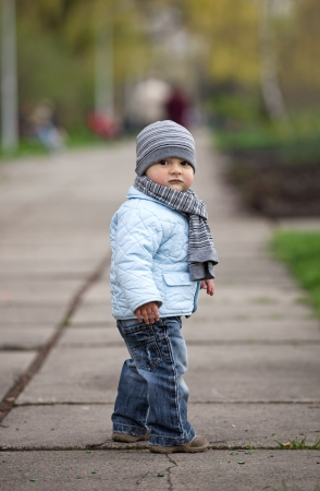 Portrait of a cute little boy outdoors photo