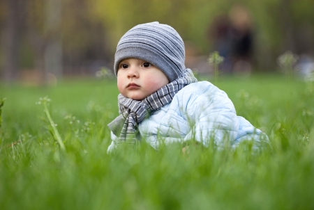 Portrait of cute little boy in park in spring photo