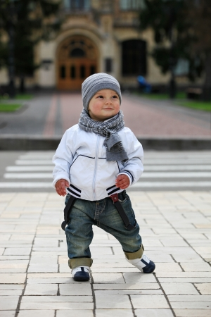 Cute little boy outdoors photo
