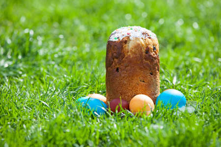 paskha: Easter cakes and painted eggs on grass