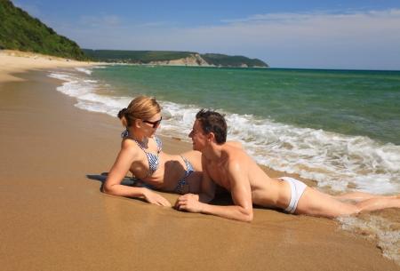 bulgaria girl: Young caucasian couple sunbathing at the beach