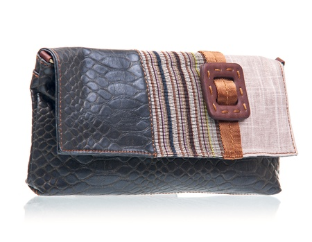 Leather clutch over white background