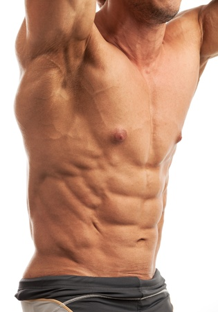Male bodybuilder flexing his muscles over white background