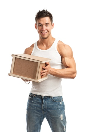 Muscular young man holding parcel over white background Stock Photo - 19250030