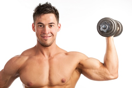 Muscular young man lifting a dumbbell over white background photo