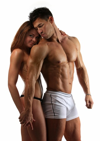'fit body': Portrait of beautiful athletic couple over white background