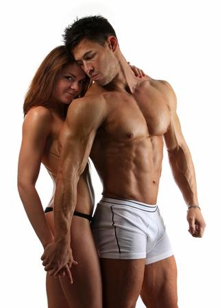 Portret van mooie atletische paar op witte achtergrond Stockfoto