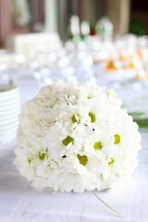 formal place setting: Decoration of the dining table for wedding reception, bouquet of daisies Stock Photo