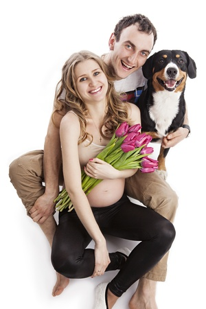 Young pregnant couple and Entlebucher Sennenhund dog over white photo