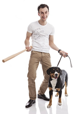 Young Caucasian man holding bat, with Entlebucher Sennenhund dog photo