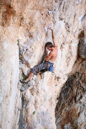 Rock climber on a cliff, vertical view Stock Photo - 20593218