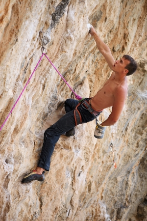 lead rope: Rock climber on a face of a cliff Stock Photo