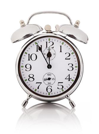 Mechanical alarm clock, isolated over white background
