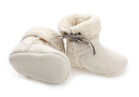 Pair of baby booties over white  photo
