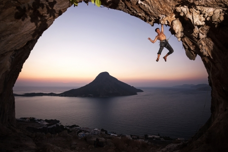 Rock climber at sunset  Kalymnos Island, Greece  photo