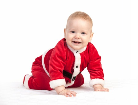 Happy little baby boy in Santa costume on white  photo