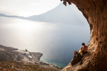 Young couple of rock climbers having a rest  Kalymnos Island, Greece  photo