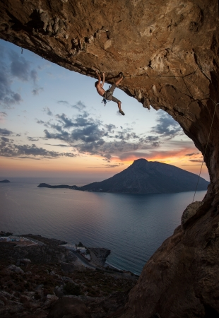 Male rock climber at sunset  Kalymnos Island, Greece photo