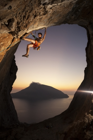 Rock climber at a sunset  Kalymnos Island, Greece photo