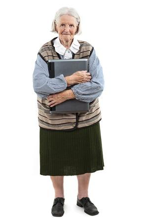 Senior woman holding laptop computer isolated on white background photo