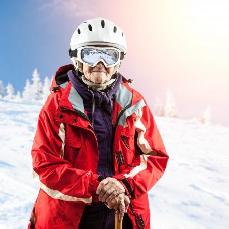 ski slopes: Senior woman in ski jacket and goggles outdoors Stock Photo