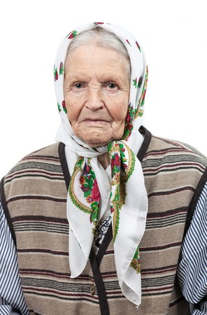 Portrait of a senior woman in headscarf looking at the camera  Over white background