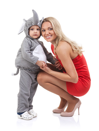 Elegant mom and baby dress as elephant over white background
