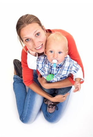 Young Caucasian woman and her baby son over white background Stock Photo - 25627773