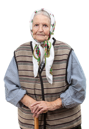 headscarf: Portrait of a smiling senior woman looking at the camera  Over white background