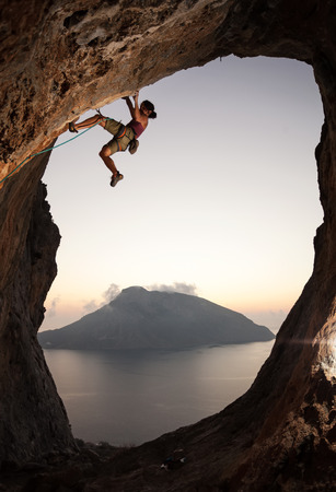 Female rock climber at sunset, Kalymnos Island, Greece photo