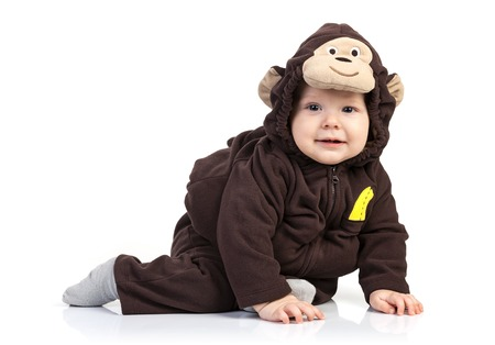 Baby boy dressed in monkey costume over white background photo