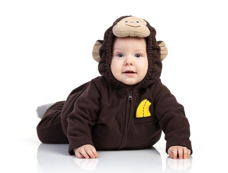 Baby boy dressed in monkey costume over white background Stock Photo