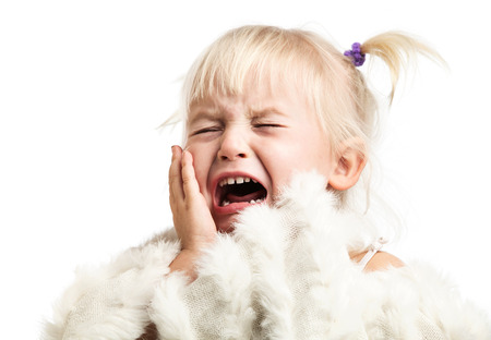 hysterical: Little girl screaming over white background