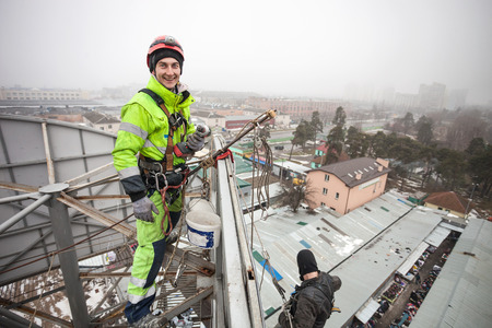 Industrial climber on a roof of a building