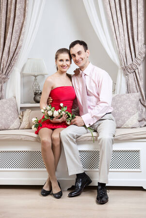 Happy young couple posing in luxury interior photo