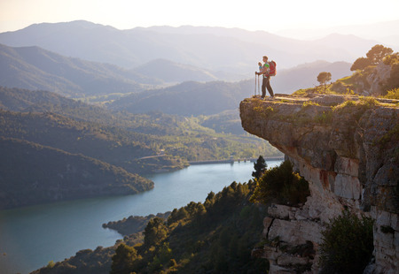 Hiker with baby relaxing on cliff and enjoying valley view  Siurana, Spain