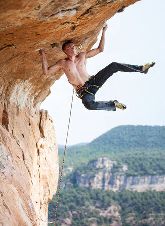 lead rope: Rock climber a face of a cliff
