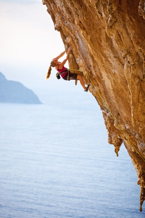 rock arch: Family rock climber at sunset. Kalymnos Island, Greece. Stock Photo
