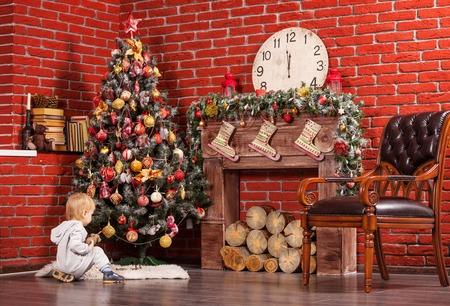 blond boy: Blonde toddler boy playing near Christmas tree