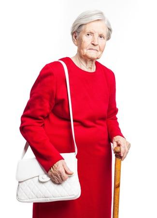 Elegant senior woman standing over white background photo