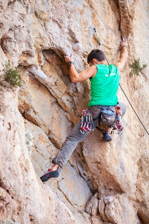 lead rope: Rock climber on a face of a cliff face