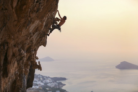 rock climb: Male rock climber at sunset, Kalymnos Island, Greece
