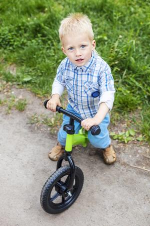 learner: Happy little boy riding learner bike