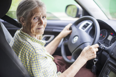 senior old: Senior woman driving a car Stock Photo