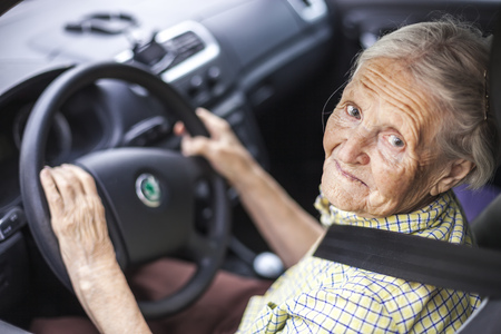 Senior woman driving a car 스톡 콘텐츠
